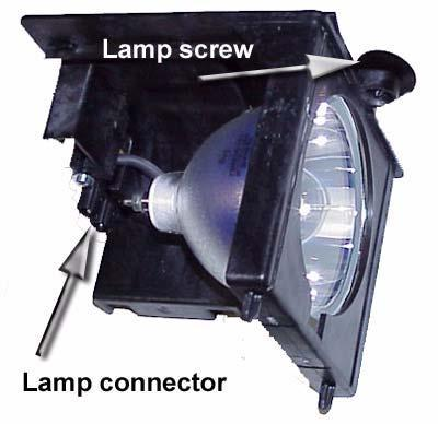 "When the screw is loose, move the lamp to the rear about 3/8"" (10 mm), then to the left, and lift it out, still connected. 8. Disconnect the lamp cable. 2. Then mount the lamp in its place."