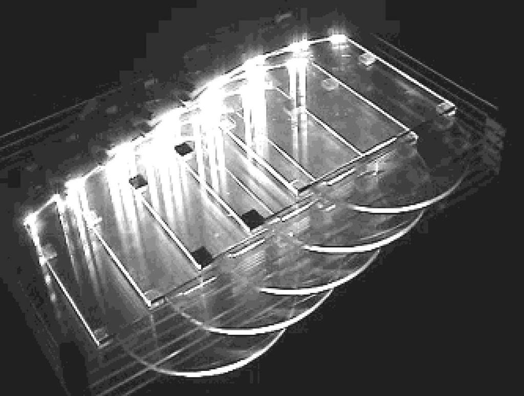 Using these construction techniques, Fig. 9 shows the first prototype element demonstrating the steering of an exit pupil beam by changing the LEDs that illuminated behind the optical element.