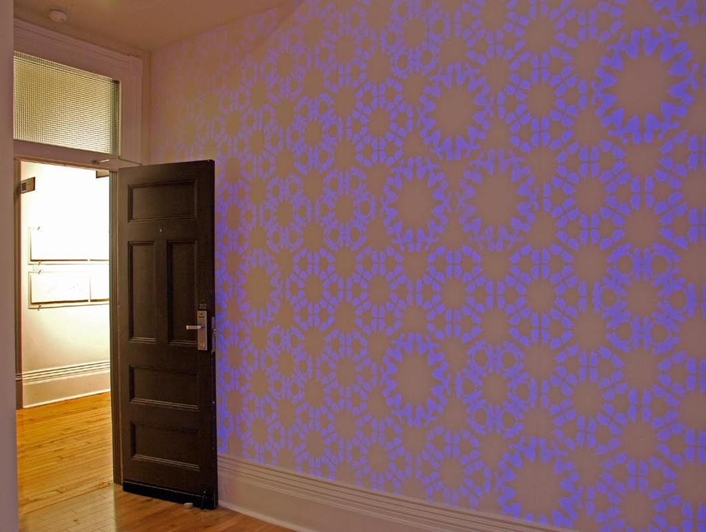 You find yourself in a small room where the walls are entirely covered with patterns made of soft polyester flocking.