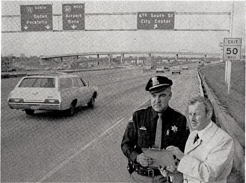 What makes a station STAND TALL? Wes Bowen of KSL confers on traffic with Utah Highway Patrolman Richard J. Brown. KSL Got Tough - - So Did The Law!