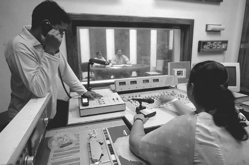 RADIO 131 Indian engineers of the state-run All India Radio (AIR) work on a phone-in program at Port Blair, 3 January 2005.