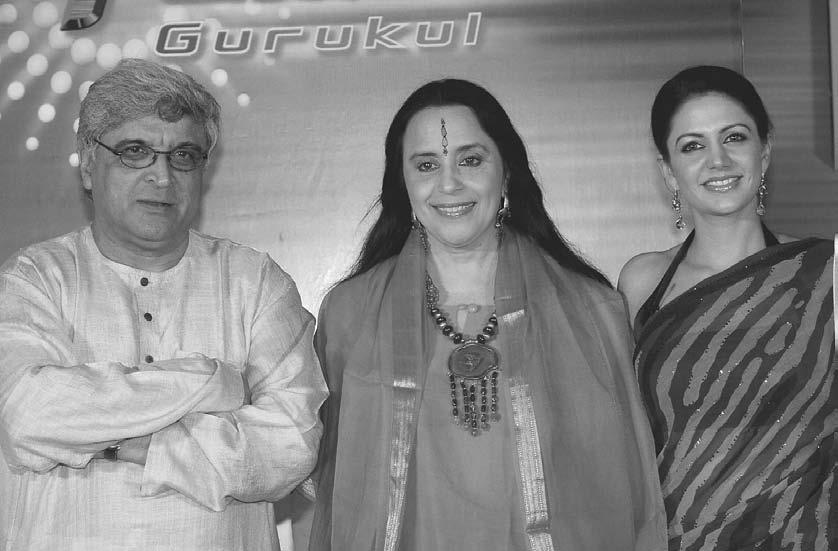 TELEVISION 163 Indian film lyricist, screenplay writer, and poet Javed Akhtar (left), singer Ila Arun (center), and actress Mandira Bedi (right) pose for photographers at the launch of Sony