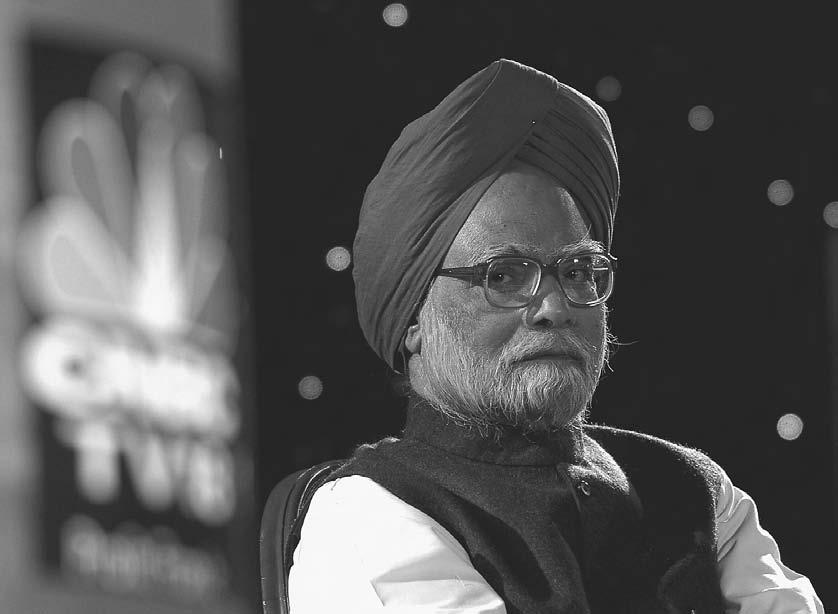 TELEVISION 165 Indian Prime Minister Manmohan Singh observes proceedings during the India Economic Conclave 2005 organized by CNBC-TV18 business news television channel in New Delhi, 13 January 2005.
