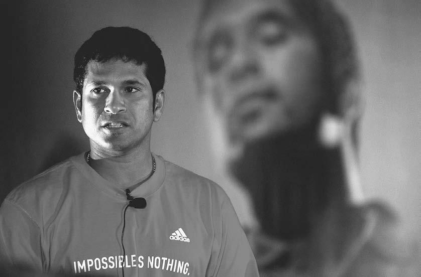 166 POP CULTURE INDIA! Indian cricket star Sachin Tendulkar speaks to reporters at a promotional event for a sports shoe company in Mumbai, 12 August 2004. (Shyam Sunder/Reuters/Corbis) 2003).