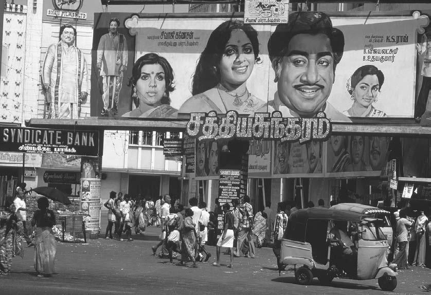 214 POP CULTURE INDIA! A giant billboard advertising a movie stands on a street in Madras, ca. 1985 1995.