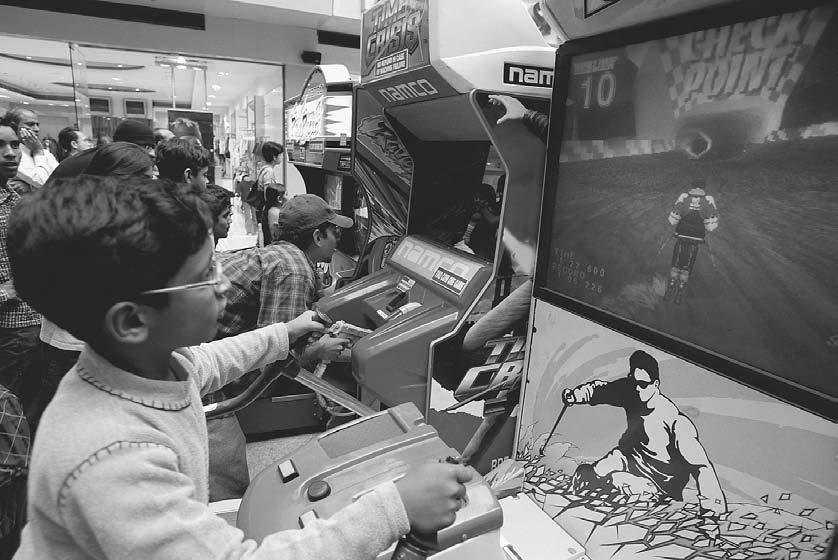 CONSUMER CULTURE 279 Children play video games at an arcade in a mall in Gurgaon, Haryana, outside New Delhi.