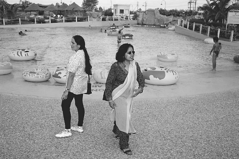 300 POP CULTURE INDIA! Women at a Western-style water park in Bangalore, 1999. (David H.