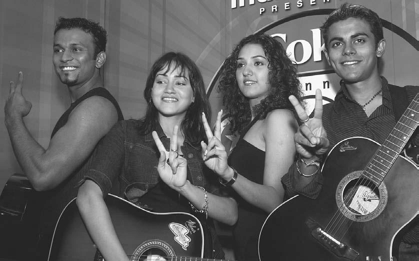 MUSIC 21 From left to right, Jimmy Felix, Vasudha Sharma, Neeti Mohan, and Sangeet Haldipur, members of the musical group Popstars 2, flash a victory sign as they pose in New Delhi 16 September 2003.