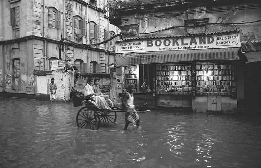 78 POP CULTURE INDIA! English-language bookstore on a flooded street. Calcutta, 1990. (Bruce Burkhardt/Corbis) ing it the seventh largest producer of books in the world.