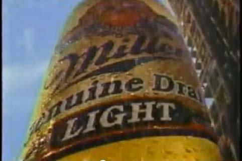 bottom, where the viewer sees the logo of Miller. While the camera moves down, For those of you looking for the big taste of Miller Genuine Draft.. is pronounced by a male voice.