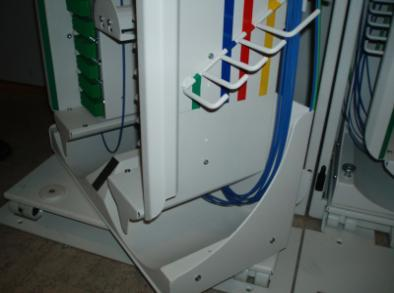 The function of the hangers is to organise surplus patch cord. The hangers placement is controlled by the surplus to be handled.