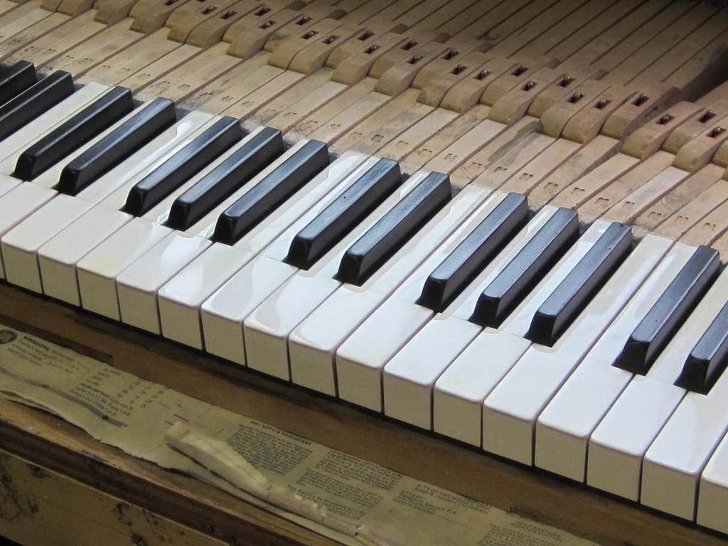 "Another shot of the same set of ivory keytops featured on the front of this article. ""In business to bring your piano to its full potential."