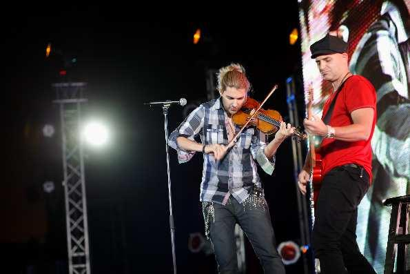 David Garrett performs with guitarist Marcus Wolf on stage and their chemistry is impeccable; both musicians feed off each other's energy and make both string instruments sound like they have