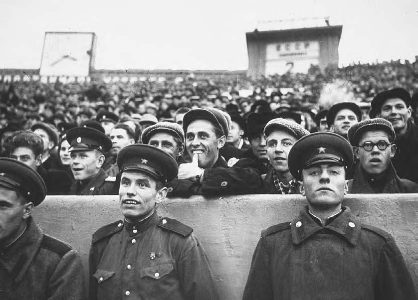 POPULAR ENTERTAINMENT 269 Disciplined soccer supporters watching a match at the Dinamo Stadium in Moscow in the early 1950s.