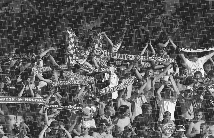 272 POP CULTURE RUSSIA! Supporters of Spartak Moscow at a match of their team against Saturn in July 2003. (Photo by Dmitry Azarov/Kommersant) that point, the police closed three of the four exits.