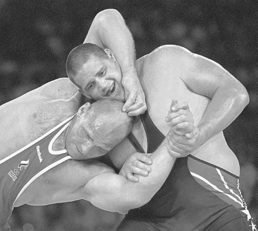 282 POP CULTURE RUSSIA! Russian three-time Olympic champion in Greco-Roman wrestling Alexander Karelin fights during the 2000 Summer Olympics in Sydney.