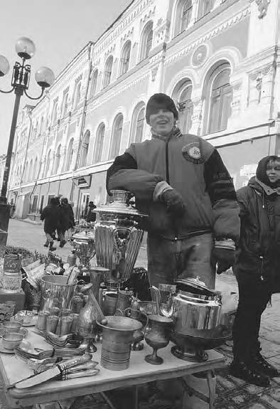 CONSUMER CULTURE 317 Moscow, 1992. A street seller selling souvenirs on the Old Arbat Street in Moscow. (Photo by Andrey Golovanov/Kommersant) painted or hand printed.