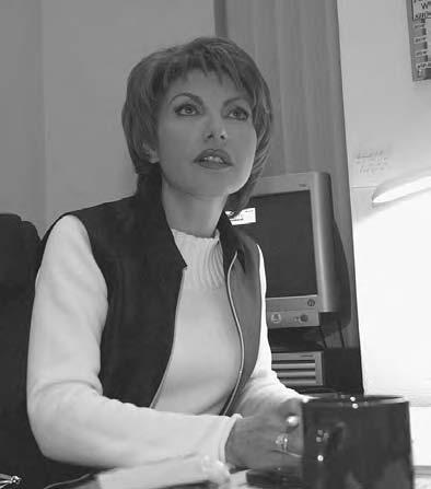 22 POP CULTURE RUSSIA! Television presenter Tatiana Mitkova in her Ostankino office, 2003.