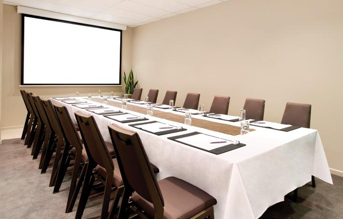 The Directors Boardroom features a retractable widescreen format projection screen (2545mm x   Additionally the room includes a high