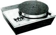 table is lathe - turned and manufactured of non- ferrous material. Underneath the table a large stroboscope disc is fitted, this being viewed through a reflecting mirror with a built -in light source.