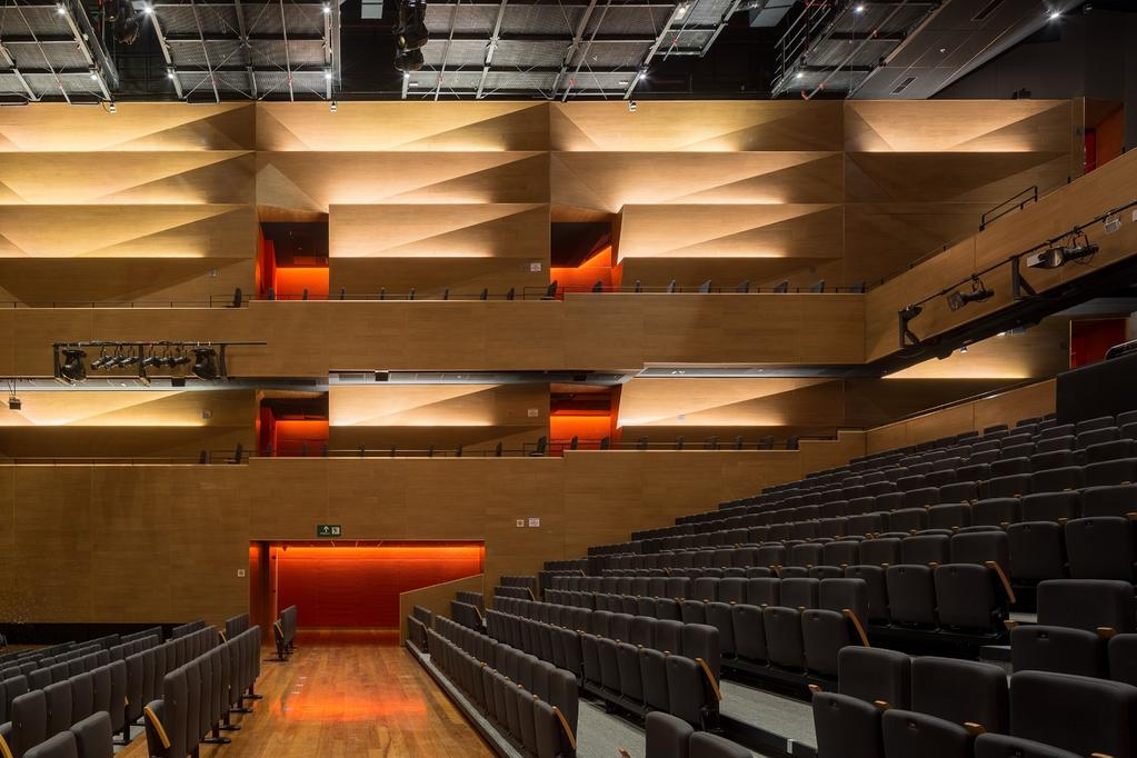 IA-250.06 The theater interior space is designed with a combination of folded acoustical wood panels and an acoustical fabric.