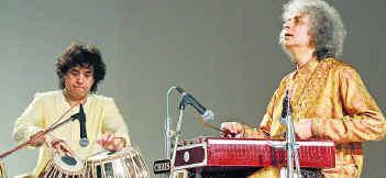 don t play in the same city with other organization. We requested him and finally on 26-2-1997 his programme was fixed at Akota Stadium. He was accompanied by Ustad Sultan Khan on Sarangi.