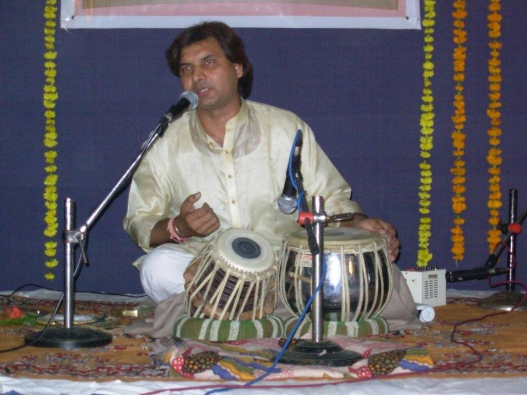 6:13 Ut.Akram Khan He is a welknown Tabla Player of Ajarada Gharana. He is emotionally attached to Baroda city. He has performed many times in Baroda.