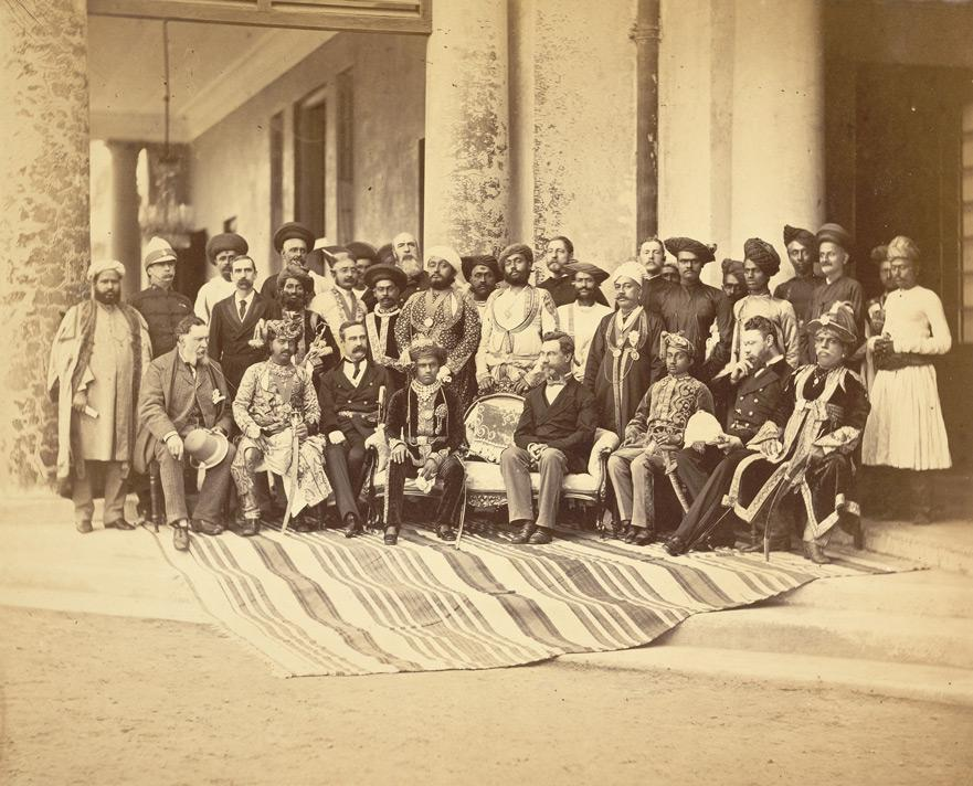 Description Group portrait of Sir Sayaji Rao, the young Gaekwar of Baroda (seated, front centre), Sir Richard Temple, Governor of Bombay and officials.