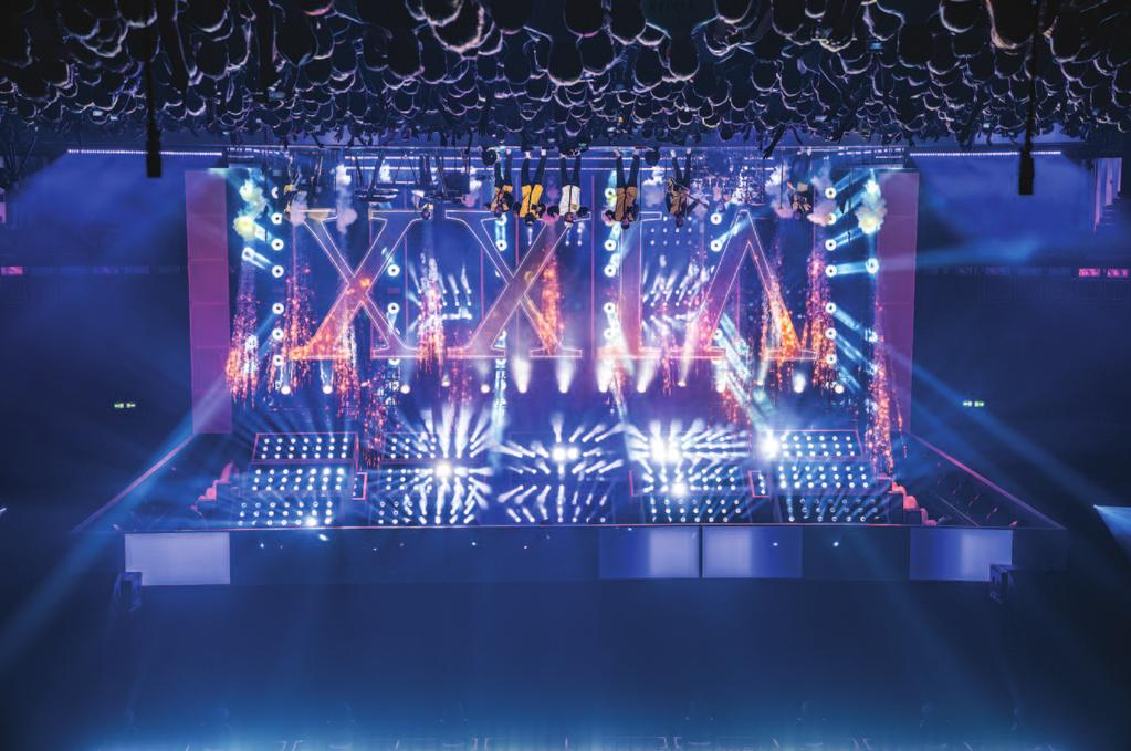 Opposite: Twelve audience-scanning and 12 high-powered lasers from Kvant are used throughout the show. Above: The XXIV sign, courtesy of Tait, appears during 24K Magic, along with pyro from Pyrotek.