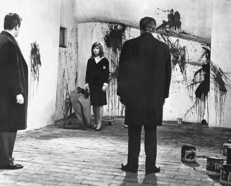 2 29. Red Desert (Italy, 1964), with Carlo Chionetti, Monica Vitti, and Richard Harris (back to camera), directed by Michelangelo Antonioni.