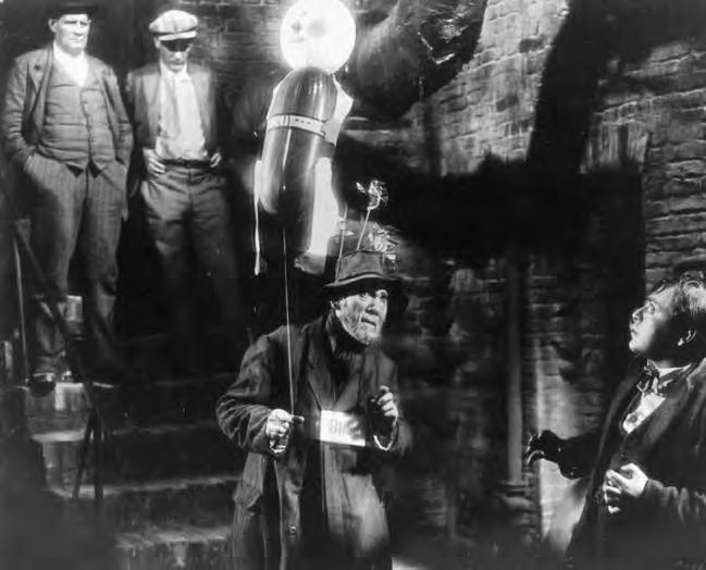 2 40. M (Germany, 1931), with Peter Lorre (extreme right), directed by Fritz Lang.