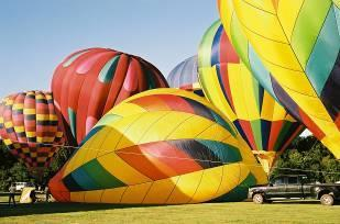 Hear the roar of burners being ignited as special shapes and colorful balloons inflate and glow against