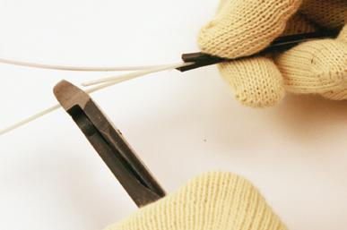 9. Using the diagonal cutters, cut the rigid strength members to the