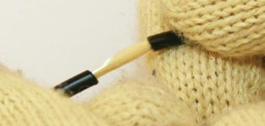 To expose the tight buffered fiber, ring-cut the