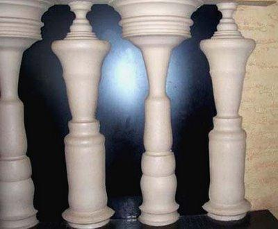 chess pieces or the black human figures in