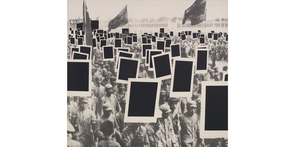 instead of revolutionary propaganda posters, the demonstrators carry copies of Malevich s Black Square. This produces a certain ironic effect.