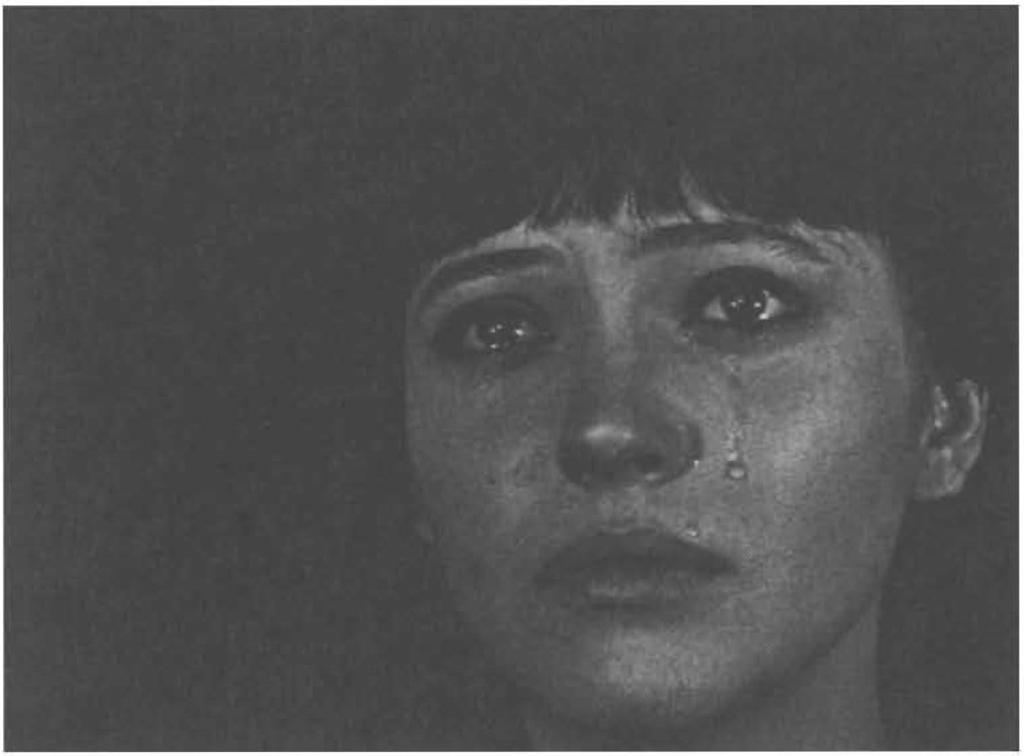 58 Cinema as mirror and face Figure 3.2 VIVRE SA VIE (FR, 1962, Jean-Luc Godard): Anna Karina (as Nana) mirroring Maria Falconetti's (as Jeanne d'arc) tears on the screen.