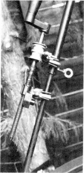 greased will turn relatively easily. The alloy bobbin is clamped to the agricultural bracket with another U bolt - a smaller exhaust clamp could be used for the purpose.