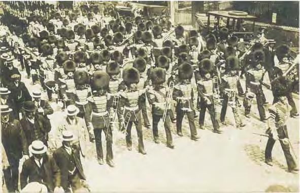 Mackenzie-Rogan (right side fronting the motor car) marches with