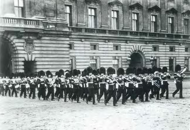Forecourt Foray: Band and Corps of Drums exit Buckingham Palace (1919).