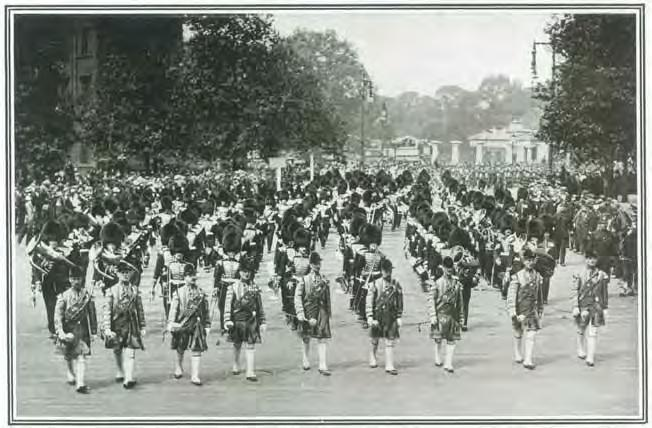 9 Drum Majors in State Dress head the first section of a 564-strong Massed Bands and Drums of