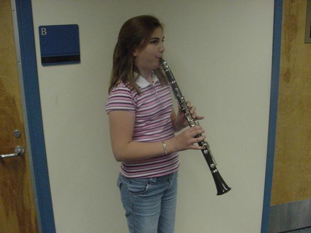 Pictured here is the CLARINET. Unlike the oboe, it has only one reed that is strapped to a mouthpiece.