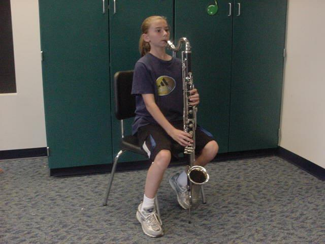 It is called the BASS CLARINET. It plays the same way as the smaller version, but plays lower notes.