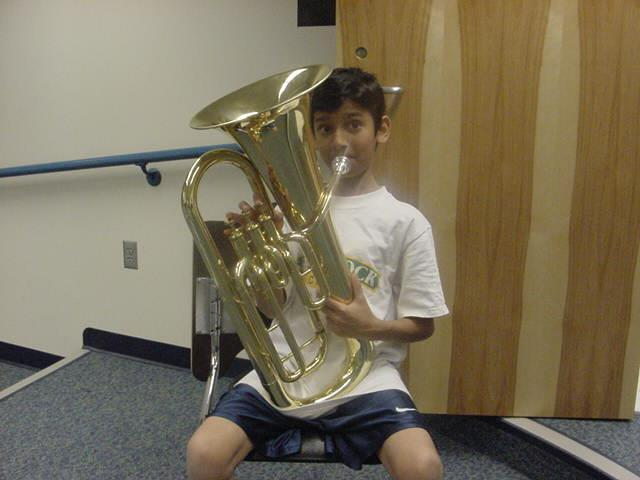 The EUPHONIUM (sometimes called the Baritone) is a low brass instrument.