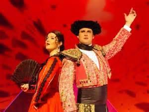 Romantic Opera Carmen by Bizet An Overture is a piece of music played at the beginning of an Opera or Musical. It has snippets of all the 'good tunes' in it.