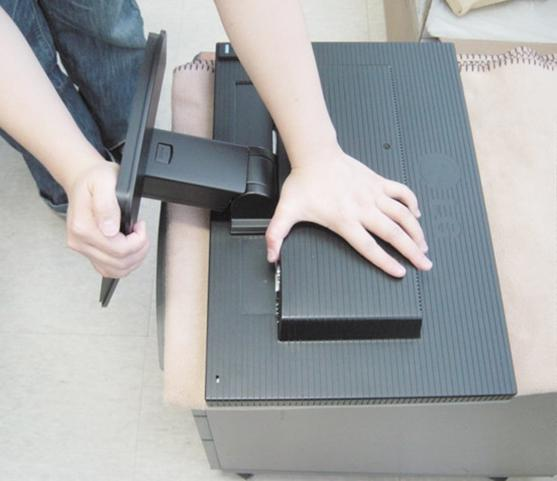 Connecting the Display To remove the Stand: 1. Put a cushion or soft cloth on a flat surface. 2.