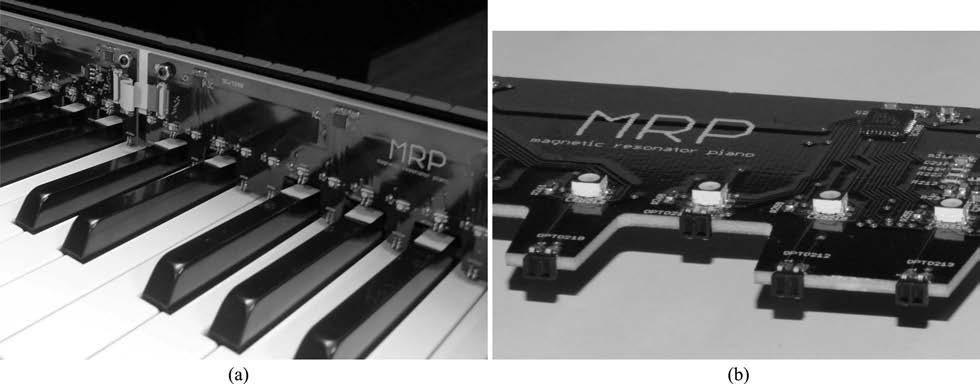 Figure 2. Optical scanner hardware. Optical sensors over each key (a). White stickers are attached to the black keys to increase their reflectance.