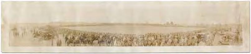 The photo depicts a baseball game in the distance surrounded by a host of soldiers, many on horseback.